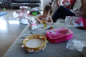 Opening presents ... now she has a tambourine!